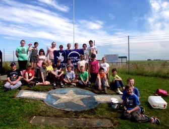 Children help to restore Horsham St Faith War Memorial