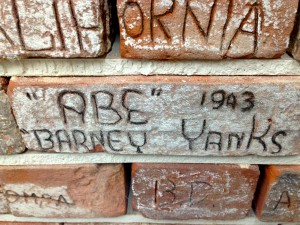 Image courtesy of the Norfolk and Suffolk aviation museum. Brick graffiti.