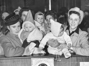 GI brides and their babies get ready to fly to America for Christmas 1946. Unfortunately, their flight was turned back because of bad weather. These women and their children had to wait for another opportunity to reach their new home.