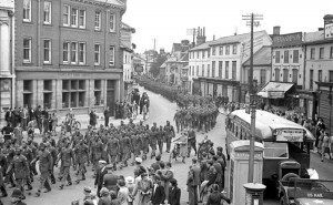 African-American troops parade through Stowmarket to celebrate the visit of Joe Louis - heavy weight champion of the World.
