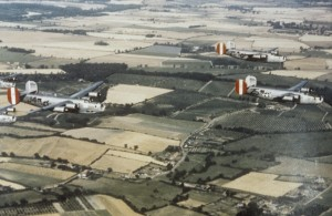 Three B-24 Liberators of the 458th Bomb Group fly in formation over countryside. Image Courtesy of the American Air Museum. FRE 67211