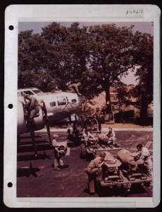 Loading Bombs onto a B-17 the caption reads 'at a base  in England' (Fold 3 Archive)