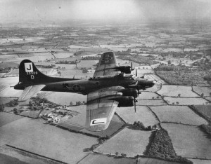 B-17 of the 390th flying over the English landscape. (FRE 1631)