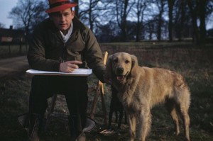 Captain H Carey, Flight Surgeon of the 356th Fighter Group, with his dog 'Don'. (FRE 6074)