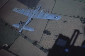 """A B-17 Flying Fortress (serial number 42-10706) nicknamed """"Miss Bea Havin'"""" of the 388th Bomb Group flies over countryside., Image Courtesy of the American Air Museum. FRE 6468"""