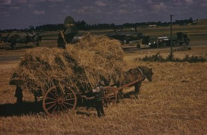 """.Farmers collect hay at Andrewsfield whilst personnel of the 322nd Bomb Group work on a B-26 Marauder (serial number 41-31814) nicknamed """"Bag Of Bolts"""".Image courtesy of the American Air Museum. FRE7089"""