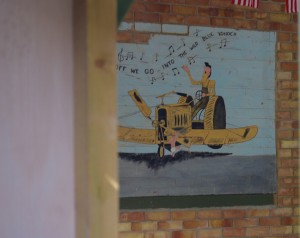 The mural restored to its home at Bottisham museum.